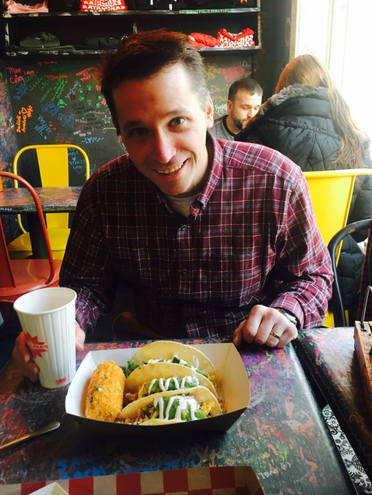 Derek, about to do battle with his immense breakfast tacos